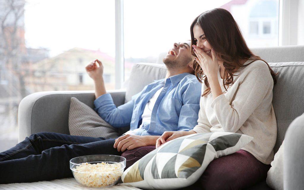 happy couple watching wedding video